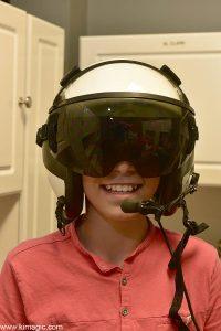 Young composer Jonathan Kravtchenko wearing pilot's helmet