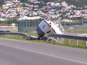 Boat on the road near Princess Juliana Airport runway in Sint Maarten