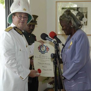 June 2003 Tony Longrigg presenting Manelwa Greenaway The Certificate of Honour from Her Majesty Queen Elizabeth the Second
