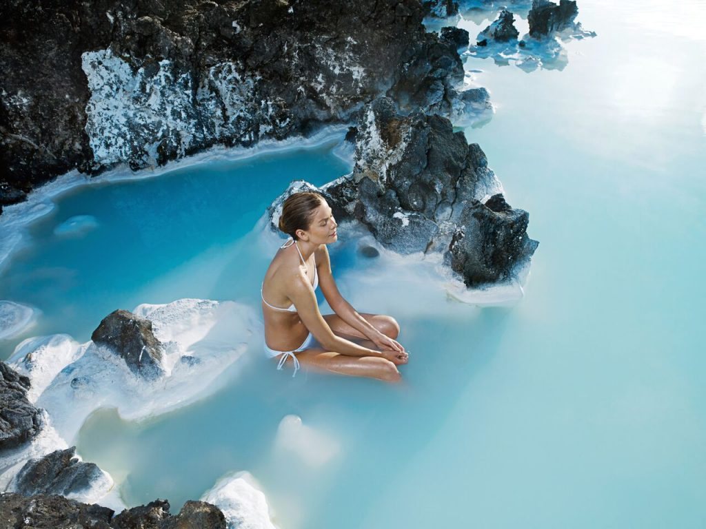 Woman in warm waters of Blue Lagoon