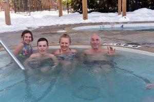 Three generations family enjoys outdoor hot tub in February at Westin Trillium Blue Mountain Resort