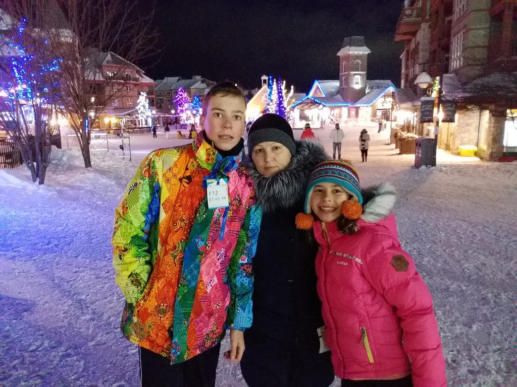 Mother and kids in Collingwood village at night