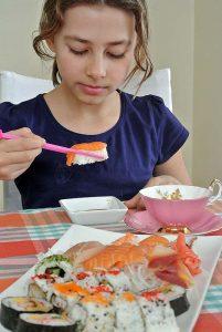 Anna Sophia is eating sushi