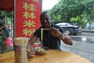 Breakfast in Yangshuo restaurant eating ramen
