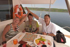 2016 June 26 Travel wirters Elizabeth Kerr, Al Luke with travel photographer Igor Kravtchenko during catamaran sailing around the Bras d'Or Lake in Cape Breton Canada