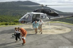 8 January 2006 Movie crew exiting from helicopter with MVO Scientist is on Helicopter flight around the active Soufriere Hills Volcano in Montserrat