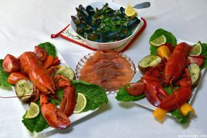 Nova Scotia Lobster meal: lobster, mussels with garlic and lemon, smoked salmon; presentation - lobster cooked to perfection, mussels in broth that can be used for seafood chowder; fresh vegetables and baked potatoes